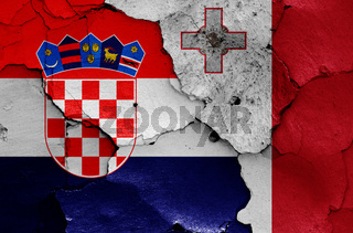 flags of Croatia and Malta painted on cracked wall