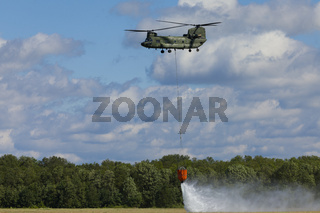 Volkel Netherlands June 13 2019: Royal Netherlands Air Force Chinook demonstrating firefighting with a Bambi bucket