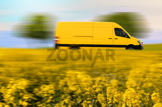 Fast parcel delivery, yellow mail van on country road.