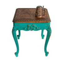 Retro wooden vintage table with green painted legs and teapot isolated with clipping path