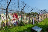 Prayer ribbons tied to the fence left by visitors wishing peace and unification for Korea