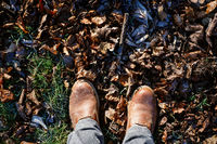 Top view on a pair of male winter shoes in autumn. Seasonal change and activity concept.
