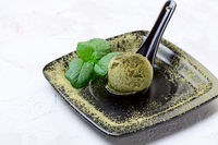Green tea and ice cream. Trendy Japanese dessert.