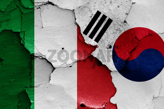 flags of Italy and South Korea painted on cracked wall