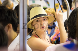 Tourist traveling by public transport.