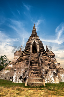 Asian religious architecture. Ancient Buddhist pagoda ruins at Wat Phra Sri Sanphet temple under sunset sky. Ayutthaya, Thailand travel landscape and destinations