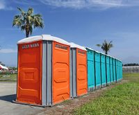 A row of portable toilets set up at a public event