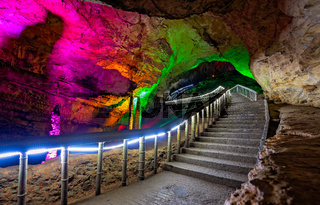 Illuminated stairs inside Huanglong Yellow Dragon Cave