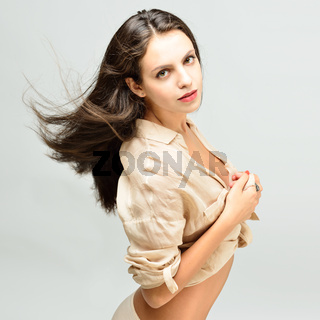 Beautiful  naked woman with long hair in light shirt