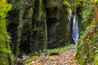 Waterfall and the creek Tiefenbach near Bernkastel-Kues on river Moselle in autumn