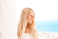 Woman with blond hair enjoying seaside and beach lifestyle in summertime, holiday travel and leisure
