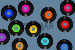 vinyl 45rpm single records on blue background
