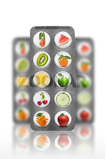 Natural pills with vitamins and fruits isolated