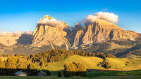 Seiser Alm, Alpe di Siusi, South Tyrol with Langkofel and Plattkofel mountain in clouds