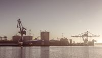 Cranes unload cargo in a seaport in Sweden