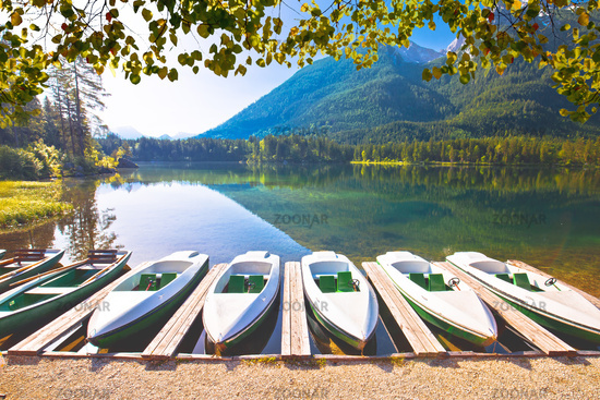 Colorful boats on Hintersee lake in Berchtesgaden Alpine landscape view