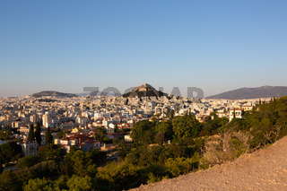 Wide view of Athens Cityscape and Mount Lycabettus at Sunset Scenic view