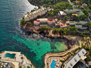 Aerial view green transparent water bay of Mediterranean Sea nd luxury coastal villas. Majorca, Spain
