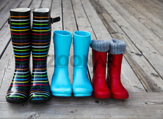 Three pairs of a colorful rain boots