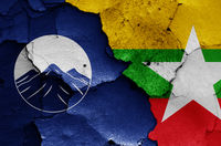 flags of Kachin State and Myanmar painted on cracked wall