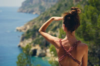 Rear view woman traveller looking into distance enjoy Costa Blanca nature view