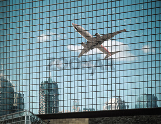 airplane are reflected on the glass curtain wall