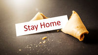 a fortune cookie with message stay home