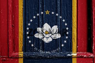 flag of Mississippi on wooden frame