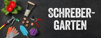 Garden tools on a dark background - Allotment Garden - Schrebergarten (German)