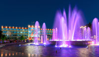Anapa, Russia - July 17, 2020: A panoramic view after sunset on the building of the city administration of the Anapa resort and a large beautiful fountain located in front of it
