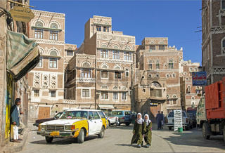 girls walking in sanaa city old town in yemen