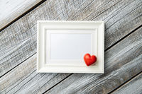Love Valentine's Day concept. Blank picture frame and heart.