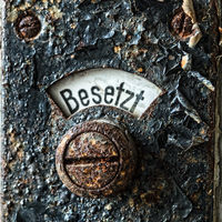 Close-up of an old rusty lavatory sign