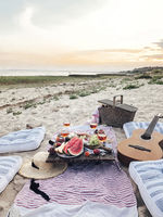Delicious food on table on beach