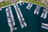 Boats moored at dock in Lovere