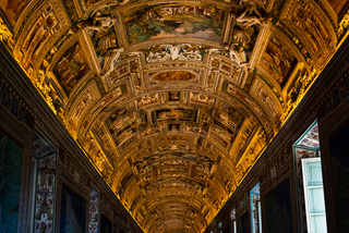 Magnificent golden ceiling in the alleys of the Vatican in Rome