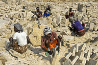Afar salt workers cut salt blocks for transportation,  Danakil Depression, Afar region, Ethiopia