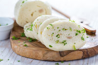 White bread dumplings (knedliky) with parsley - traditional Czech cuisine.