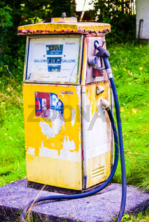 Rusted old gas pump in derelict garage