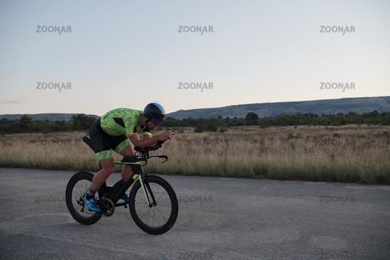 triathlon athlete riding a  bike