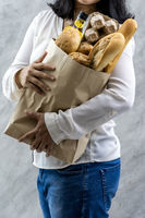 Close up Asian housewife woman hold grocery dairy bag.