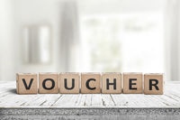 Voucher sign in a bright room