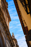 Blue sky view between ancient architecture of Granada old town. Spain