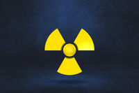 Radioactive symbol on a dark blue studio background