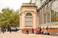 Classical street music quartet playing at Buen Retiro Park during Autumn