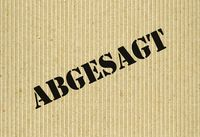 Abgesagt (Cancelled) on cardboard