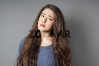 unhappy sad young woman frowning