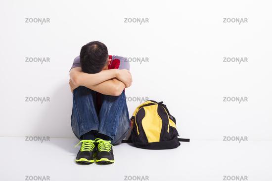 terrified student  sitting on the floor