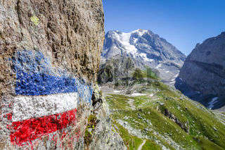 Flag of france painted on a rock in French alps.