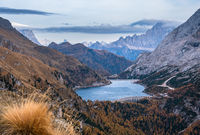 Autumn Dolomites mountain view from hiking path betwen Pordoi Pass and Fedaia Lake, Italy.